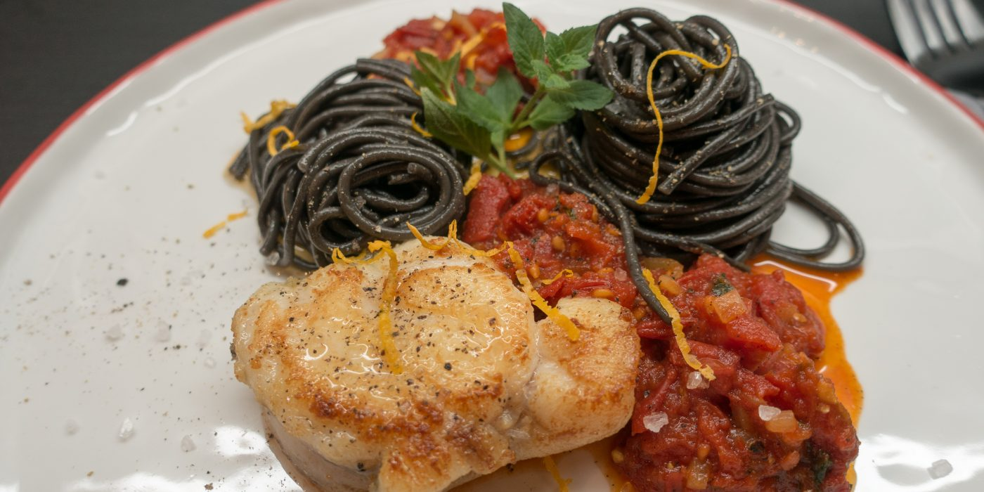 Monkfish with Sepia-Pasta and Tomato Sauce