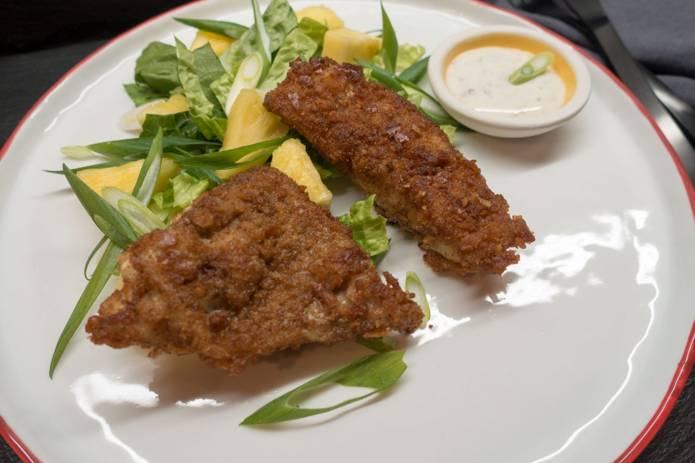 Crispy pollack fillet with salad
