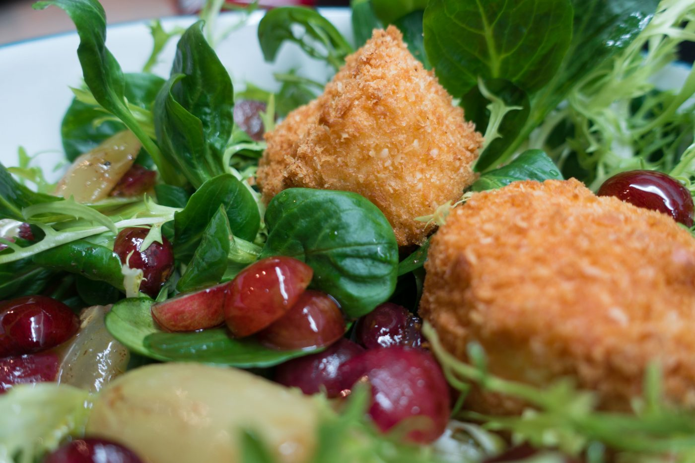 Goat cheese in panko breading with winter salad
