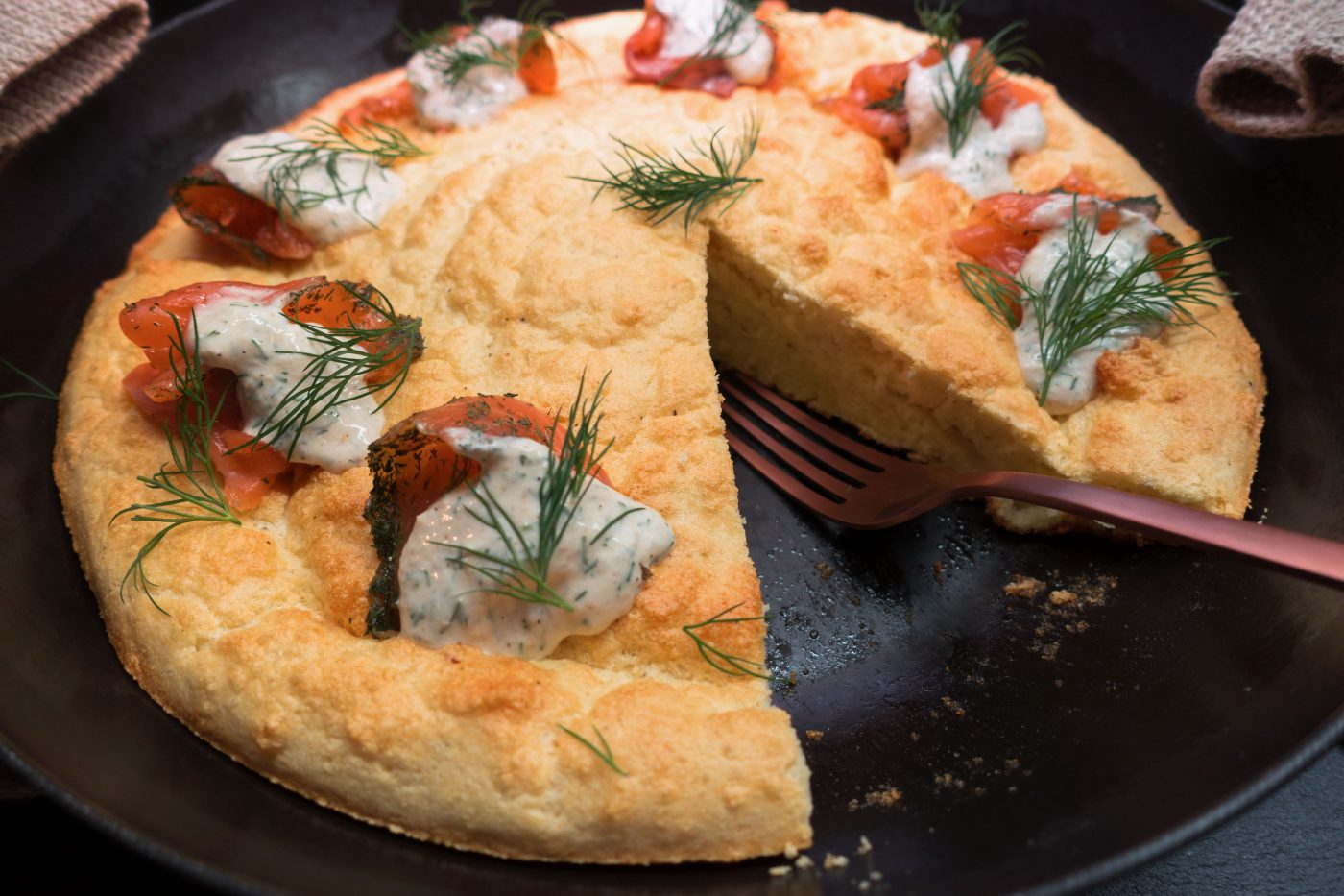 Finnish oven pancakes traditionally served with salmon, fresh herbs and horseradish cream