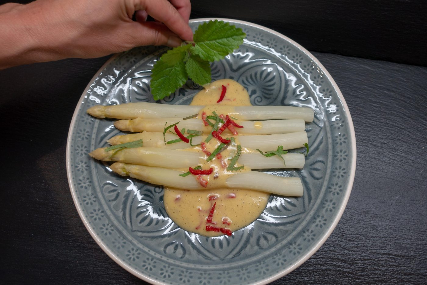 Asparagus with vanilla hollandaise, garnished with lemon balm