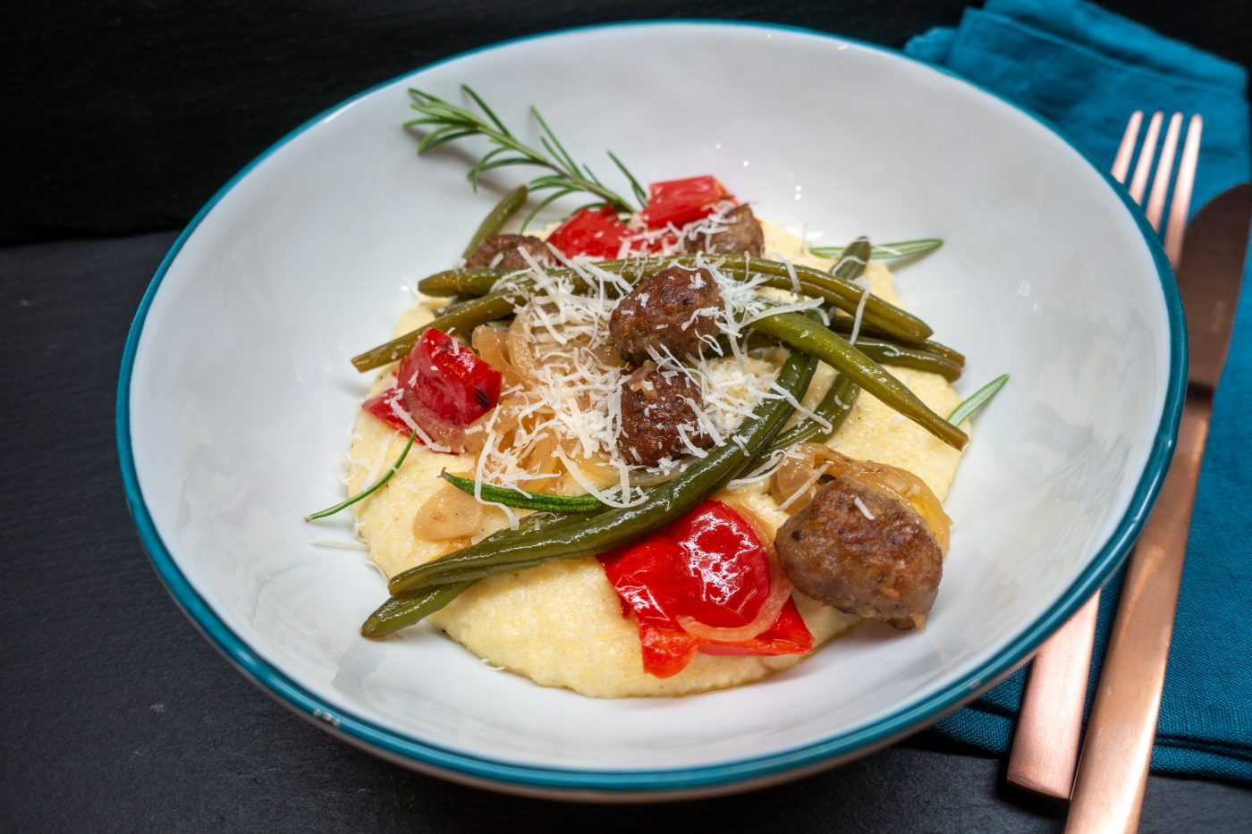 Fennel meatballs with vegetables on creamy polenta