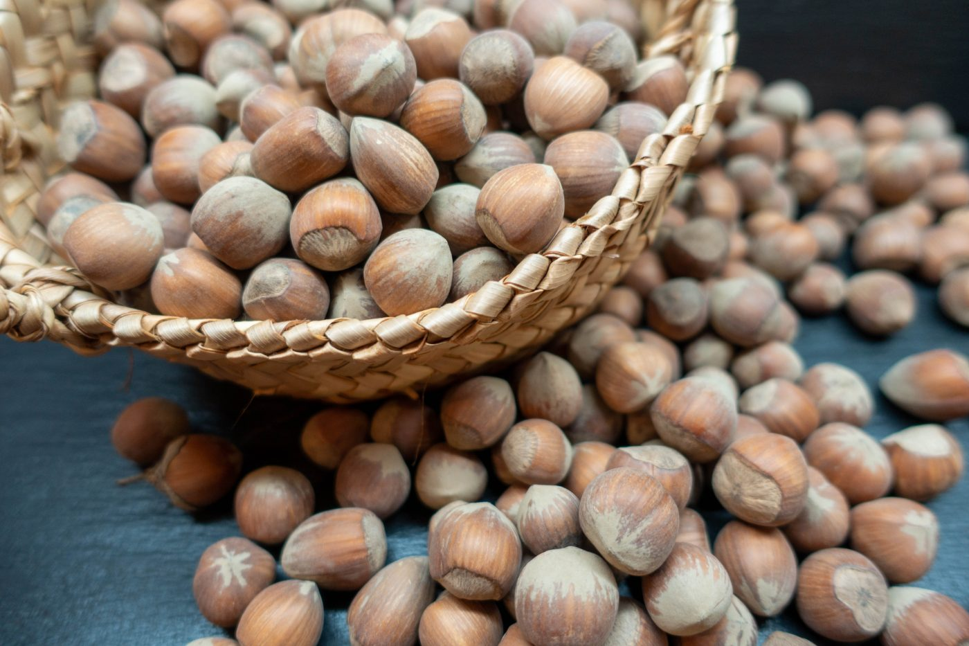 Hazelnuts in and in front of a basket for my nut bread recipe
