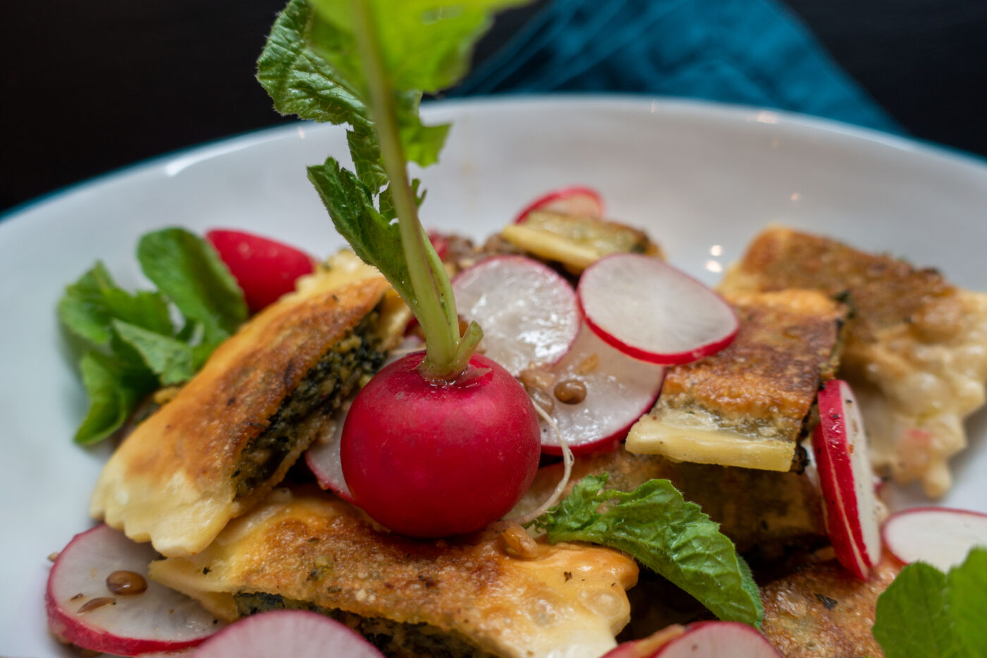 Maultaschen with radish and lentil vinaigrette